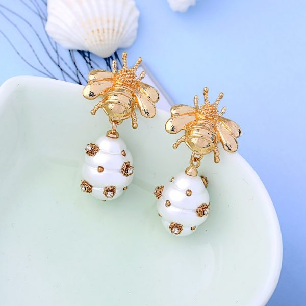 gold insect earrings